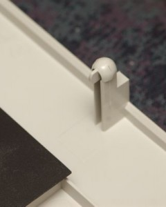 The hinge thingy (on lid, shown upside down)
