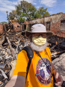 The author in front of the rubble of Uncle Hugo's Science Fiction Bookstore, wearing a Have Spacesuit, Will Travel t-shirt